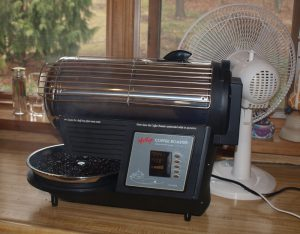 Hottop Ejecting Coffee. Notice and smoke rising from the coffee.